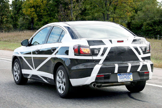 Today spy photographers caught in little camo new 2010 Mazda 3 sedan.