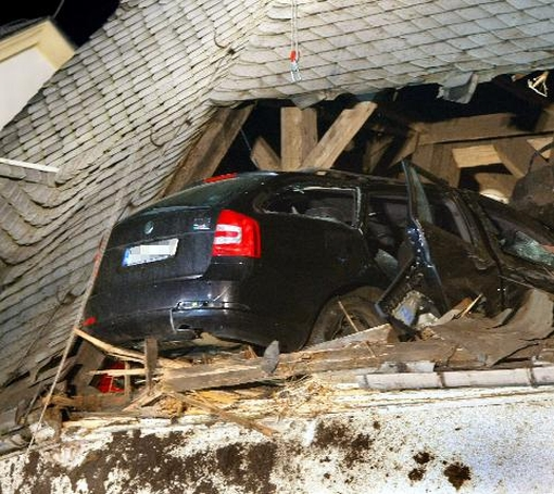 Very strange Accident: Car Lands on Church Roof in Germany
