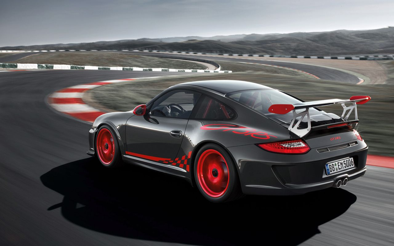 new 2010 porsche 911 gt3 rs revealed with 450hp engine. Black Bedroom Furniture Sets. Home Design Ideas